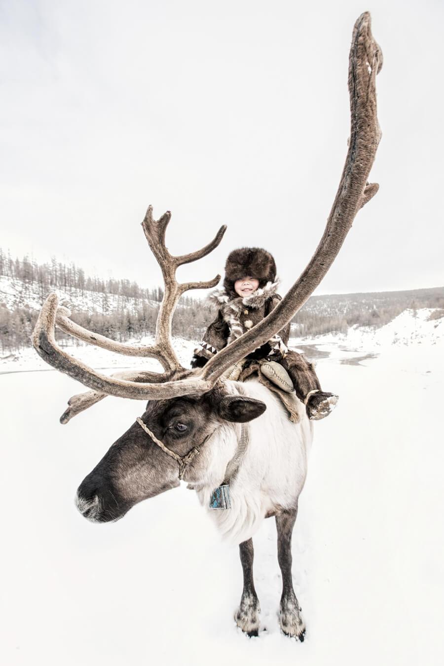 Якутия. Эвенкийский мальчик из семьи оленеводов. © Александр Химушин / The World In Faces
